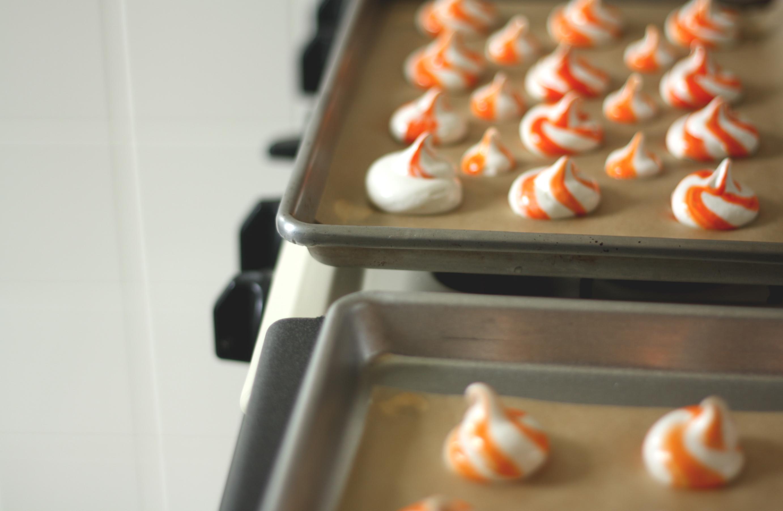swirled creamsicle meringues