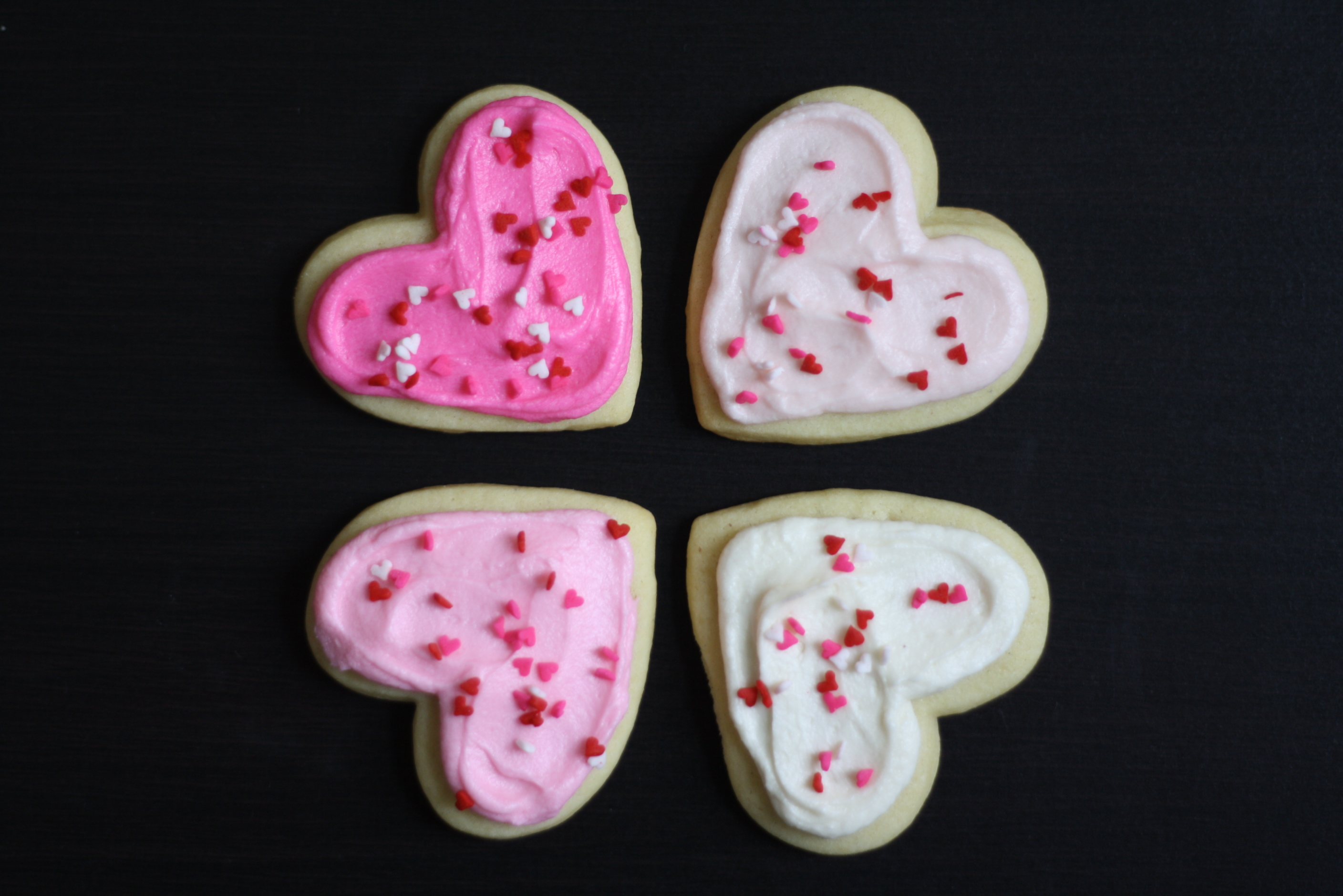 four frosted cookie hearts